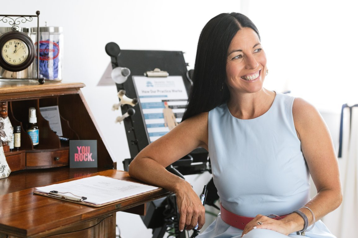 Dr. Amy Horn sits at a desk